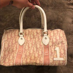Pink and cream round arm satchel bag